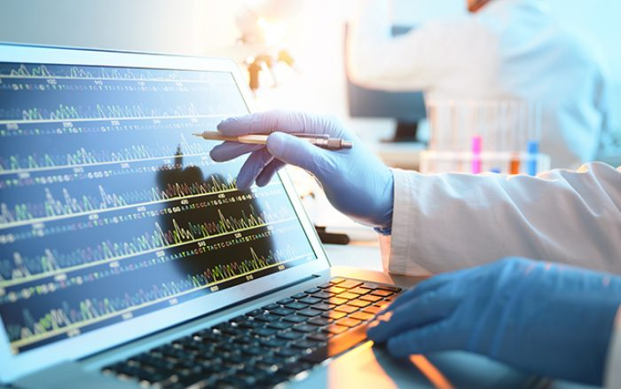 A scientist looking at a DNA sequence